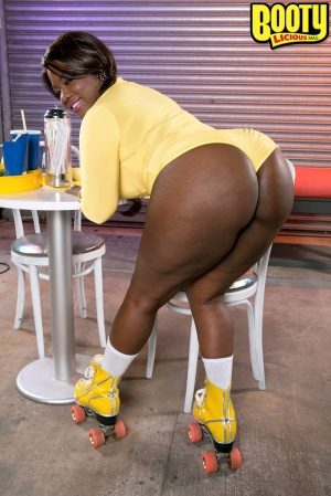 Black BBW ass bending over a chair
