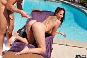 Huge Oiled Booty by the Pool